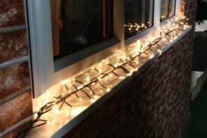 Installing Christmas lights around windows