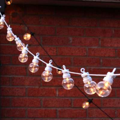 festoons hung on brick